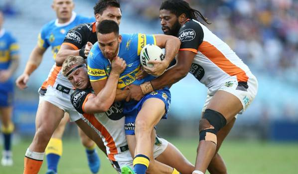 Corey Norman of the Eels is tackled.