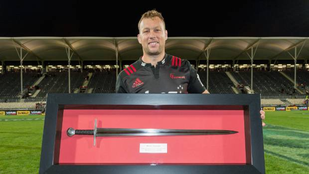 Wyatt Crockett sports a ceremonial sword to mark his record 176th Super Rugby appearance. He could be packing down ...