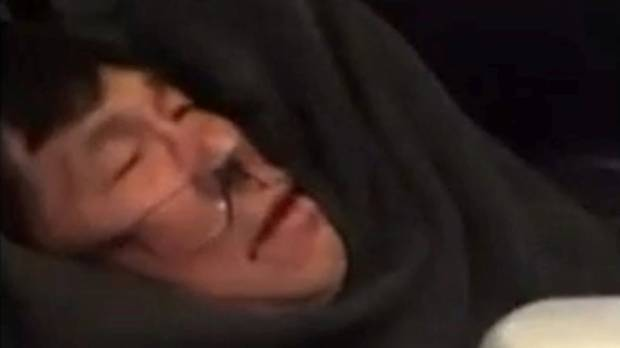 A video screen grab shows passenger Dr David Dao being dragged off a United Airlines flight at  O'Hare International ...