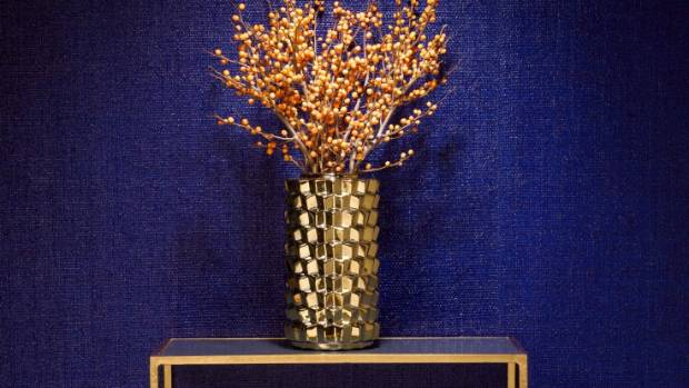 Phillip Jeffries lacquered raffia wallcovering has a hint of metallic, offering a glamorous finish.
