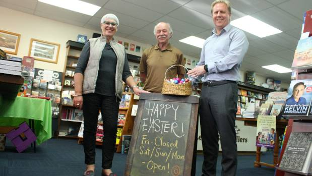 Rotorua Mayor Steve Chadwick, McLeods Booksellers' Michael Byrne and MP Todd McClay in celebratory mood ahead of the ...