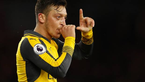 Mesut Ozil celebrates scoring Arsenal's second goal in a 2-1 win over Middlesbrough.