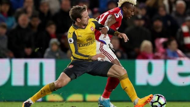 Arsenal's Nacho Monreal  (L) challenges Middlesbrough's Adama Traore.