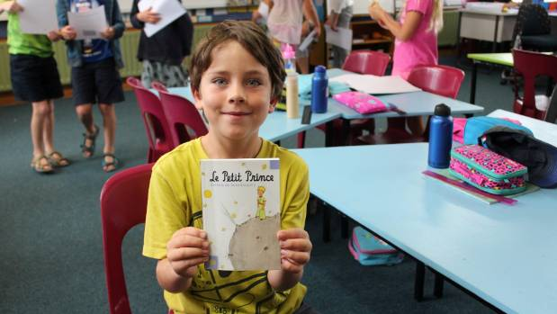 Matthew Stubbs enjoys reading a French classic at Birkdale North School.