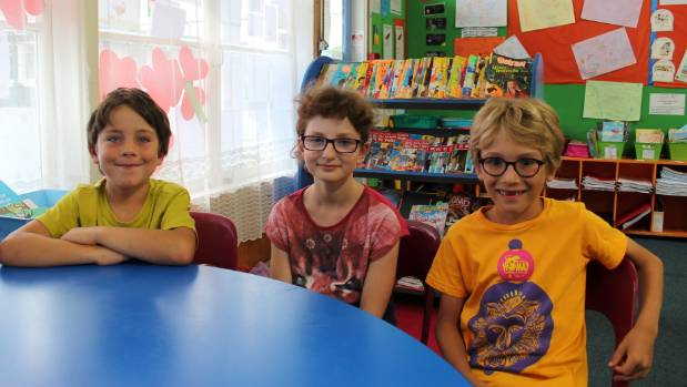 Matthew Stubbs, Dahlia de Chantal and Xavier Courteau-Laing enjoy learning in both French and English at l'Etoile du ...