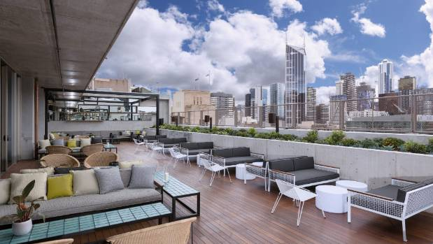 The outdoor view of the Melbourne skyline from the QT Rooftop Bar.