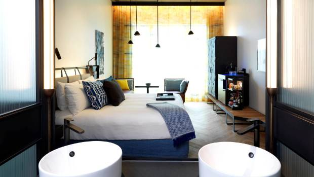 Large modern rooms at the QT scream luxury with their sleek style.
