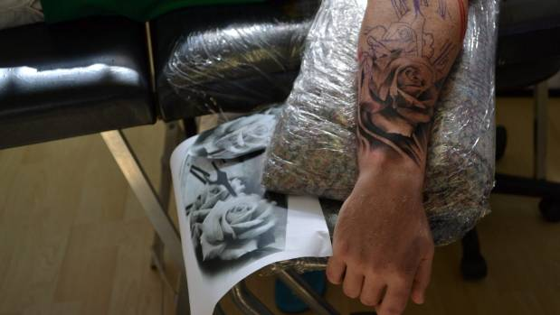 Sam Clayton says roses and skulls are always popular tattoos.