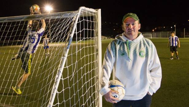 Brendan Holland coaches his son's football team at St Patrick's College in Kilbirnie.