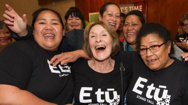 Kristine Bartlett, centre, celebrates with Telani Esene, left, and Eneata Apineru.