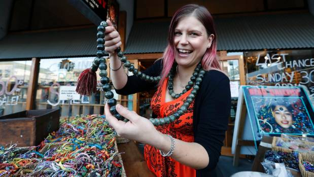 Odette Turner wearing a bead Mala (prayer beads),  outside the Bead Gallery in Hardy St which is closing at the end of April.