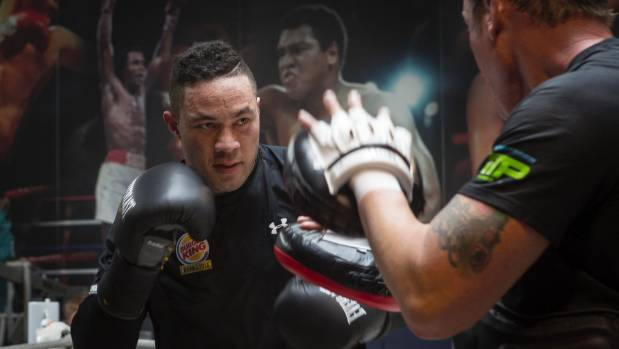 Joseph Parker rips into some pad work with his trainer Kevin Barry.