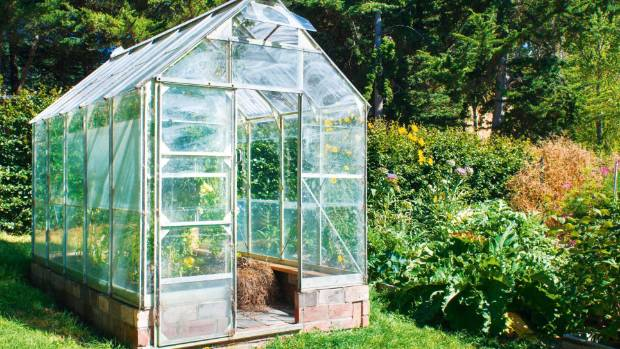 A small glasshouse extends the growing season.