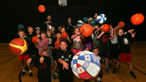 Southland Basketball development officer and SIT Zero Fees Southland Sharks players Derone Raukawa and Luke Aston help ...