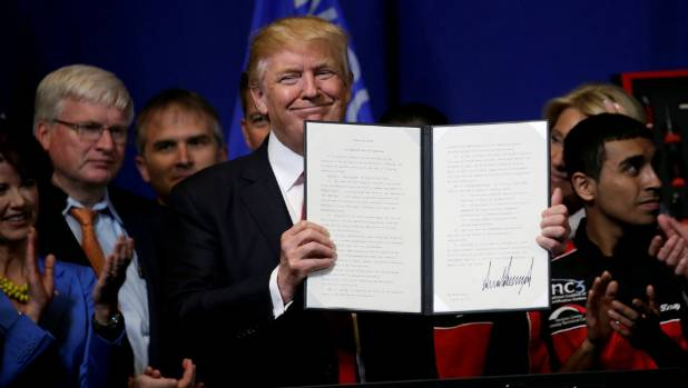 US President Donald Trump signs order to review H-1B visa programme
