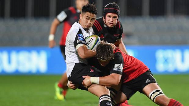 Yu Tamura of the Sunwolves is tackled by Quinten Strange during his Crusaders' debut on Friday.