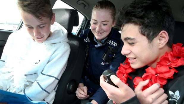 William Harvey, 13, and Tama More, 14, competing in a code cracking challenge at the Invercargill Police station with ...