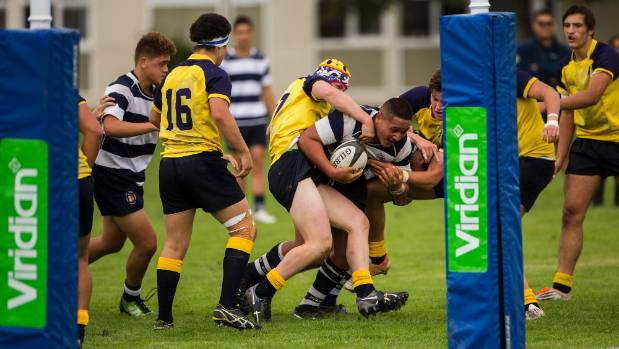 Palmerston North Boys' High School prop Usaiah Fonongoloa fights his way over the tryline for one of his two tries.