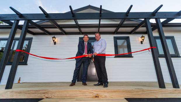 New Plymouth MP Jonathan Young and Manor Build general manager Tim Suckling welcomed people to view their four-bedroom ...