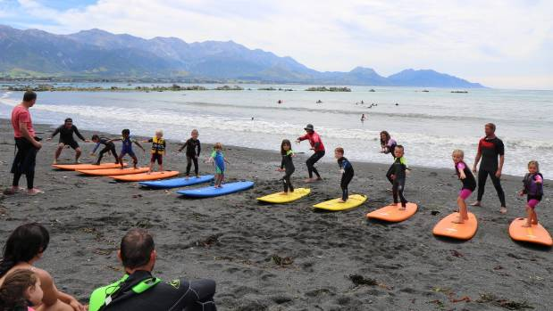 Kaikoura kids line up for surf lessons on the new surf break at Gooch's Beach.