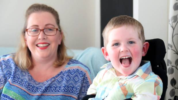 James Swan, 4, with mum Nicola. He is losing the ability to walk and eat normally, due to a mystery illness.