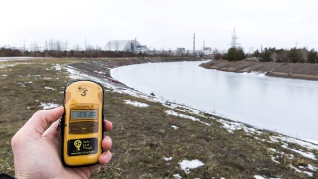 A geiger meter constantly alerts to the high levels of radiation.