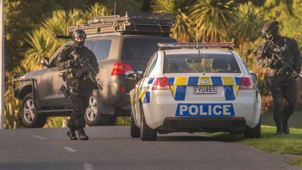 Armed police swooped on a property in Rakaia Huts near Southbridge on Thursday morning, after a shooting near Rolleston ...
