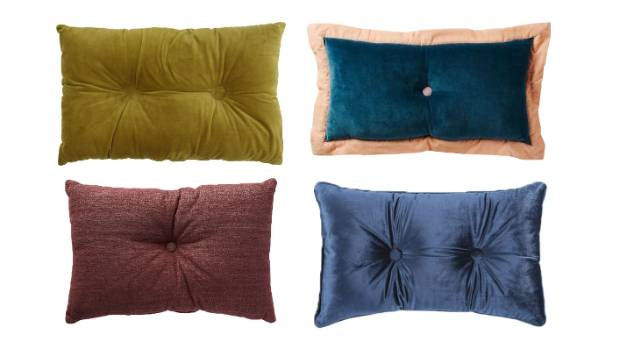 Button hole cushions are having a day. Clockwise from top left: Wallace Cotton noble rectangle button cushion, $39.90; ...