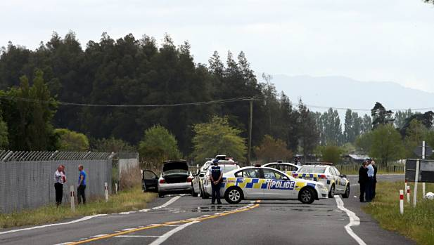 Police at the scene of the 2014 shooting of an armed Kerepehi man who threatened to shoot his partner and police (FILE).