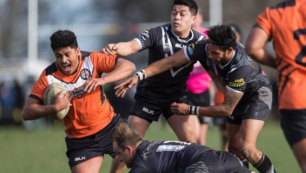 Papanui Tigers league player Damien Papuni escapes the clutches of Hornby Panthers players during a match in 2016.