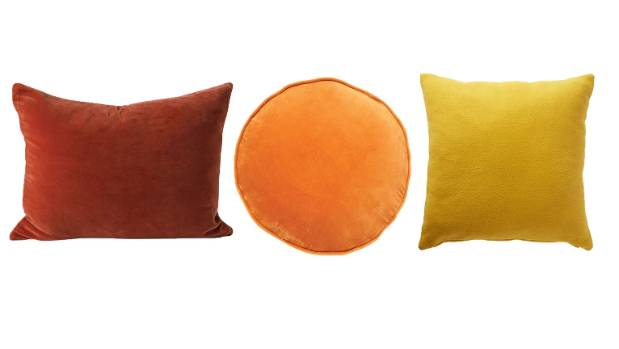 Burnt oranges and mustard yellows. From left: Citta cotton velvet cushion, $44.90; Kip and Co nectar velvet pea cushion, ...