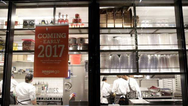 Kitchen staff are pictured inside the Amazon Go brick-and-mortar grocery store  in Seattle Washington, US.