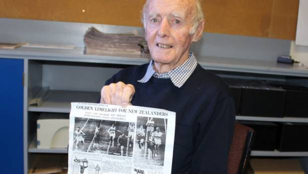 Retired reporter Jim Wallace with his Weekly News press cutting, showing his story after Peter Snell and Murray Halberg ...