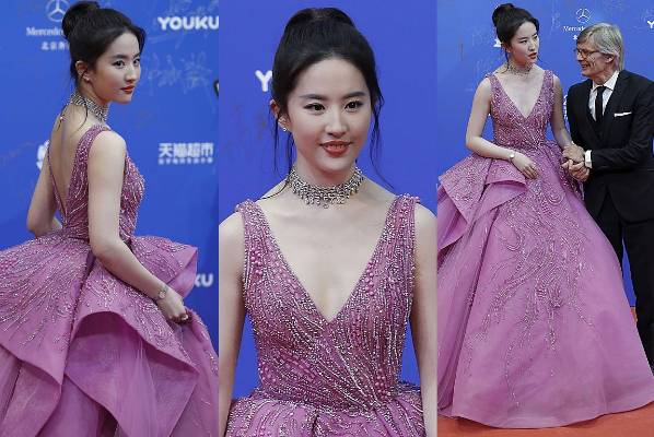 THE GOOD: Chinese superstar Liu Yifei looks quite literally like a tea cosy or cake topper doll in this saccharine gown ...