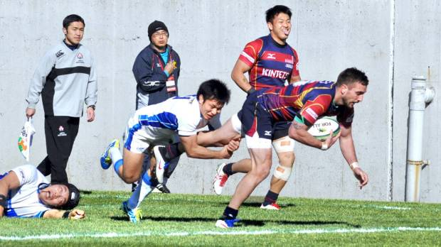 Andre Taylor scores one of his two tries for the Kintetsu Liners against Kyuden Voltex earlier this year.