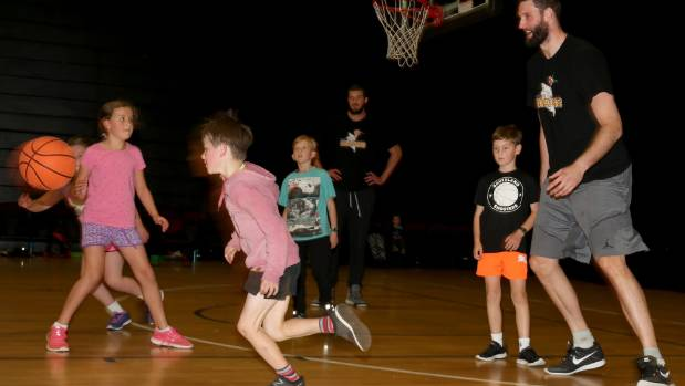 Southland Sharks players James Hunter and Alex Pledger help teach Southland kids some basketball skills at the Southland ...