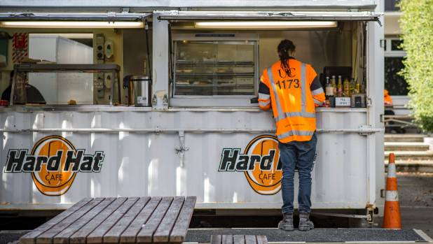 A tradesman working at the University of Canterbury buys morning tea at the Hard Hat Cafe. Construction workers have ...