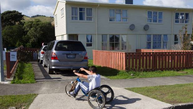 A year after the Porirua siege, a child plays outside the unit where gunman Pita Te Kira holed up for two days but was ...