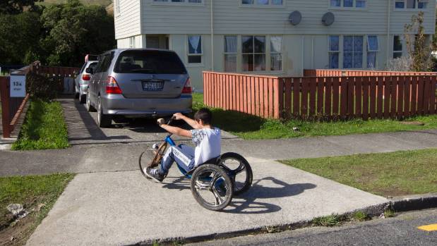 A year after the Porirua siege, a child plays outside the unit where gunman Pita Te Kira was holed up for two days but ...