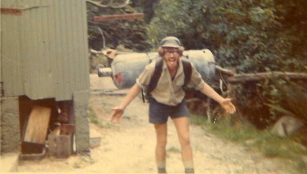 Ken Bradley carrying a gas cylinder to Pomplona Lodge on the Milford Track in the early 1970s.