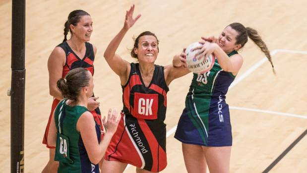 Richmond goal keep Amy Cunningham tries to disrupt Jacks goal shoot Hannah Mead's ball during their Premier netball ...