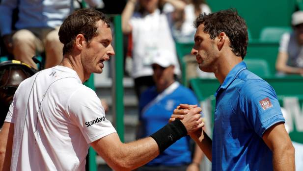World No 1 Andy Murray (left) blew a 4-0 third set lead to lose to 15th-seeded Albert Ramos-Vinolas of Spain.
