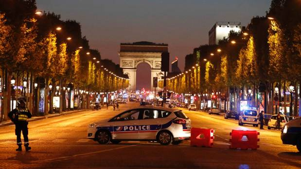 Police secure the Champs-Elysee Avenue after one policeman was killed and another fatally wounded in a shooting incident ...