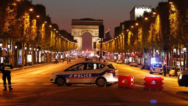 Police secure the Champs Elysees after one policeman was killed and another wounded in a shooting incident in Paris, France.