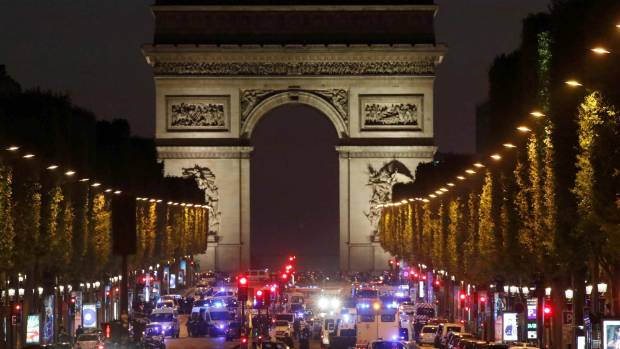 Champs-Elysees Avenue swarms with police after the attack.