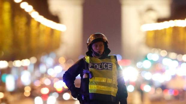 A policeman stands guard on the Champs-Elysees.