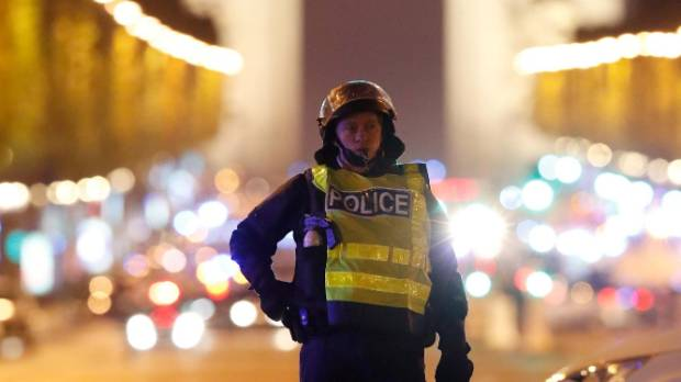 Police secure the Champs Elysees Avenue after one policeman was killed and another wounded in a shooting incident in Paris.