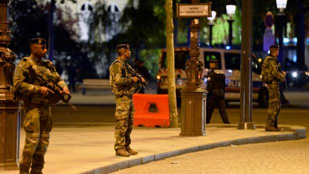 A pedestrian was also wounded after a two police officers were shot on the Champs-Elysees.
