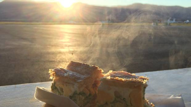 "The ""NASA bacon and egg pie'' from the Warbirds and Wheels Cafe at Wanaka Airport lets off steam on the media bench ..."