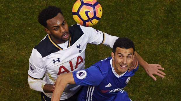 Danny Rose of Tottenham Hotspur and Pedro of Chelsea battle to win a header during their most recent Premier League match.